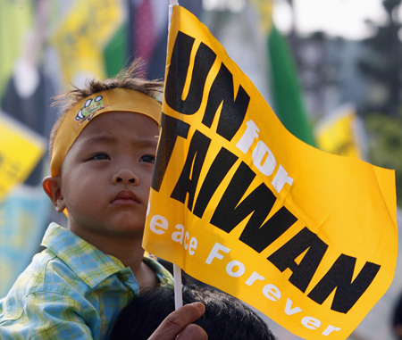 """A child attends a rally titled """"U.N. for Taiwan"""" in Kaohsiung"""