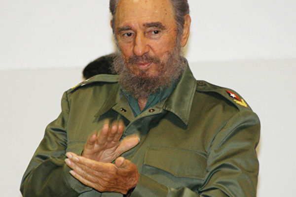 Cuban President Fidel Castro applauds du